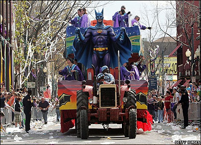 Mardi Gras has given residents of New Orleans a good excuse to celebrate since Hurricane Katrina hit their city in August. This Batman float works its way past the cheering crowds lining the streets.