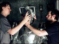 Cyberman having helmet fitted