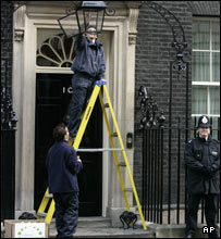Changing the light bulb outside 10 Downing Street