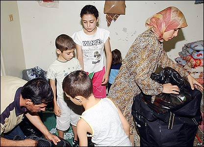 Displaced Lebanese pack their belongings in Damascus, Syria