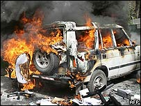 A jeep burns in Jericho