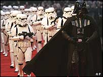 Darth Vader accompanied by stormtroopers
