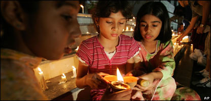 Kids light candles to remember those who died in the earthquake
