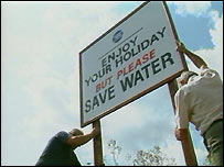 Sign asking people to save water