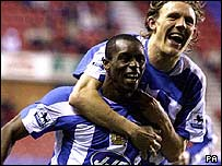 Wigan Athletic's Henri Camara (L) celebrates his first goal against Aston Villa, with team-mate Jimmy Bullard