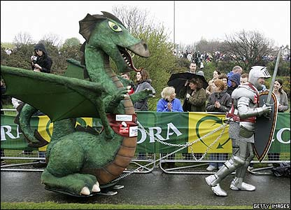 Fundraiser Lloyd Scott starts the Marathon in a suit of armour and dragging a dragon - well it is St George's Day!
