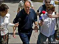 Luiz Felipe Scolari is mobbed by the media.