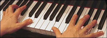 Person playing a keyboard