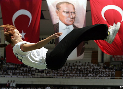 A Turkish gymnast shows off her skills during the Youth and Sport Festival celebrations at Inonu Stadium, Istanbul.