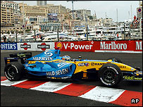 Fernando Alonso of Spain steers his Renault