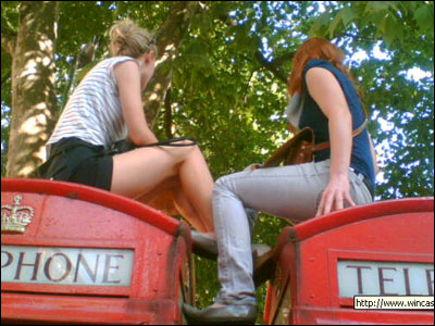 This brave duo clambered on top of phone boxes outside the screening in London's Leicester Square