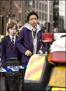 Two of the young stars, Sanchez Adams (who plays Ben) and Michael Curtis Parsons (who plays Jack) filming outside London Liverpool Street station