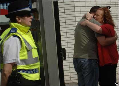 It was an emotional day for many people. Two people comfort each other at King's Cross, while a police officer looks on