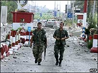 Lebanese soldiers walking through rubble