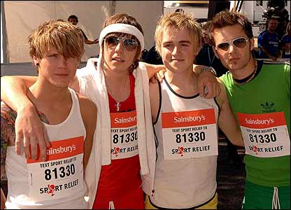 Members of the band McFly prepare to run