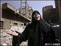 A woman cries after her Beirut home was bombed by Israel