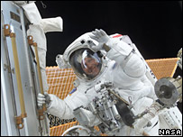 Astronaut waves on a space walk