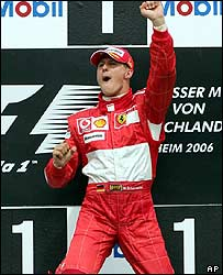 German Ferrari racer Michael Schumacher jumps up on the podium after winning the Formula 1 German Grand Prix