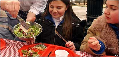 Children eating healthy school meals
