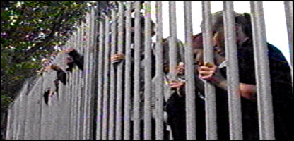 Pupils order their food through the school fence