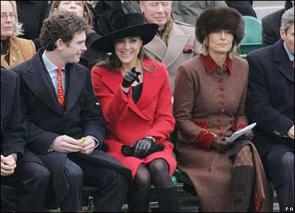 William's girlfriend Kate came to the ceremony with her mum and dad. Who could she be pointing at?
