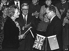 Mrs Thatcher and Zhao Ziyang holding formal handover documents