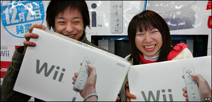 Customers in Japan clutch the Wiis