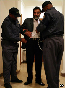 Saddam is taken to court