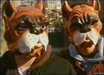 The anonymous artists in their dog masks