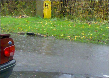 Emma, 9, from Fen Drayton in Cambridgeshire sent in this picture of the front of her home where a ditch has flooded