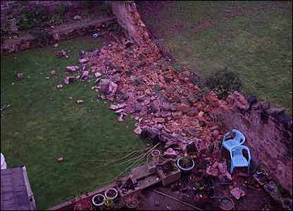 Ben in Birkenhead sent in this picture of a sandstone wall that has blown down. As it fell it crushed a  small tree and a bench along with an entire row of flowers