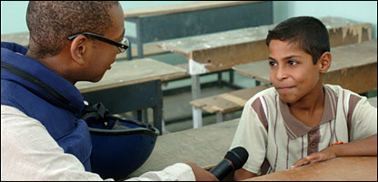 Lizo interviewing a child in Iraq. Picture by Cpl Wayne Beeching/Crown copyright