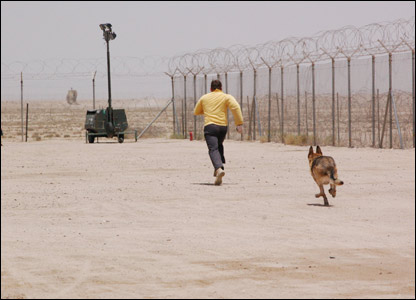Military dog chasing a dog away in a demonstration