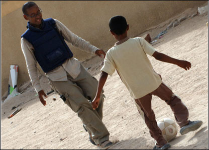 Lizo playing footie with Iraqi kids. Picture by Cpl Wayne Beeching / Crown copyright