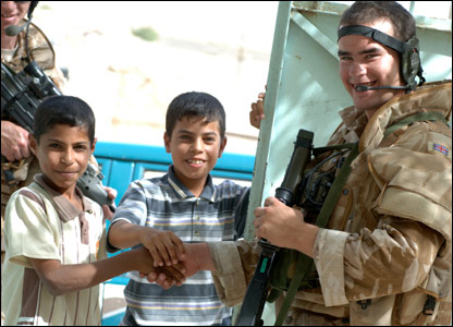 Iraqi kids with British troops. Picture by Cpl Wayne Beeching / Crown copyright