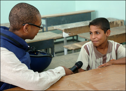 Lizo interviewing a child in Iraq. Picture by Cpl Wayne Beeching / Crown copyright