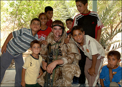 Iraqi kids with one of the troops. Picture by Cpl Wayne Beeching / Crown copyright