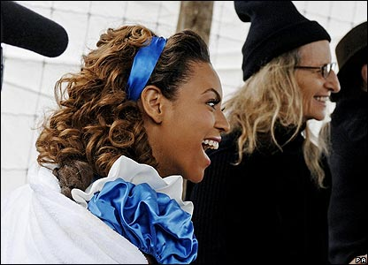 Becks was one of several big stars to dress up as a character from a fairytale for the ad. Here's Beyonce as Alice in Wonderland!