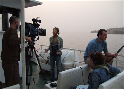 Angellica filming on the boat to Goree Island