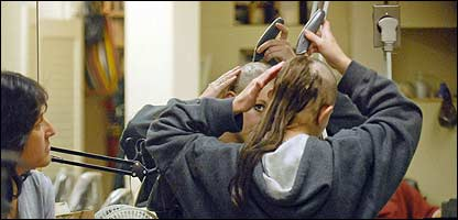 Britney shaving her hair off