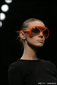 Do you think this model can actually see where she's going as she struts her stuff on the catwalks of Milan in Italy?