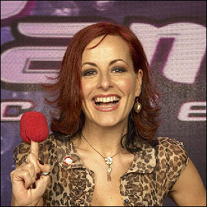 Carrie Grant is a vocal coach - she teaches the students how to improve their singing technique.