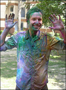 Adam got covered in paint while he was filming the festival for Newsround