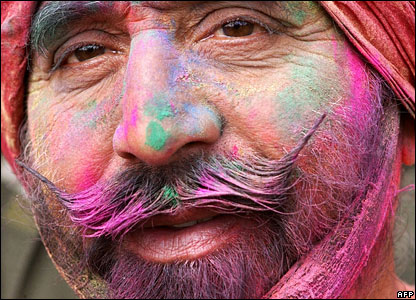 It's not just the kids who get involved. This man was left with a multi-coloured face after he was covered with the  dyes and paint.