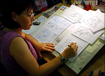 Artist working on storyboards