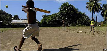 A child playing cricket in the West Indies