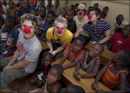 Dougie, Tom, Danny and Harry of McFly in Uganda