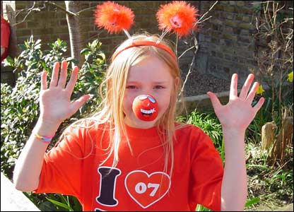 Saskia, 9, wears some furry red deely boppers with her red nose and T-shirt.