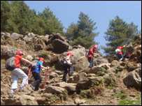 The Young Everest team trekking uphill