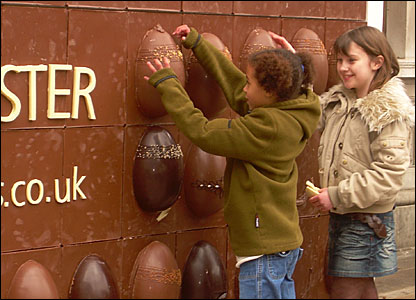 Kitty and Elen trying to get the eggs off the billboard
